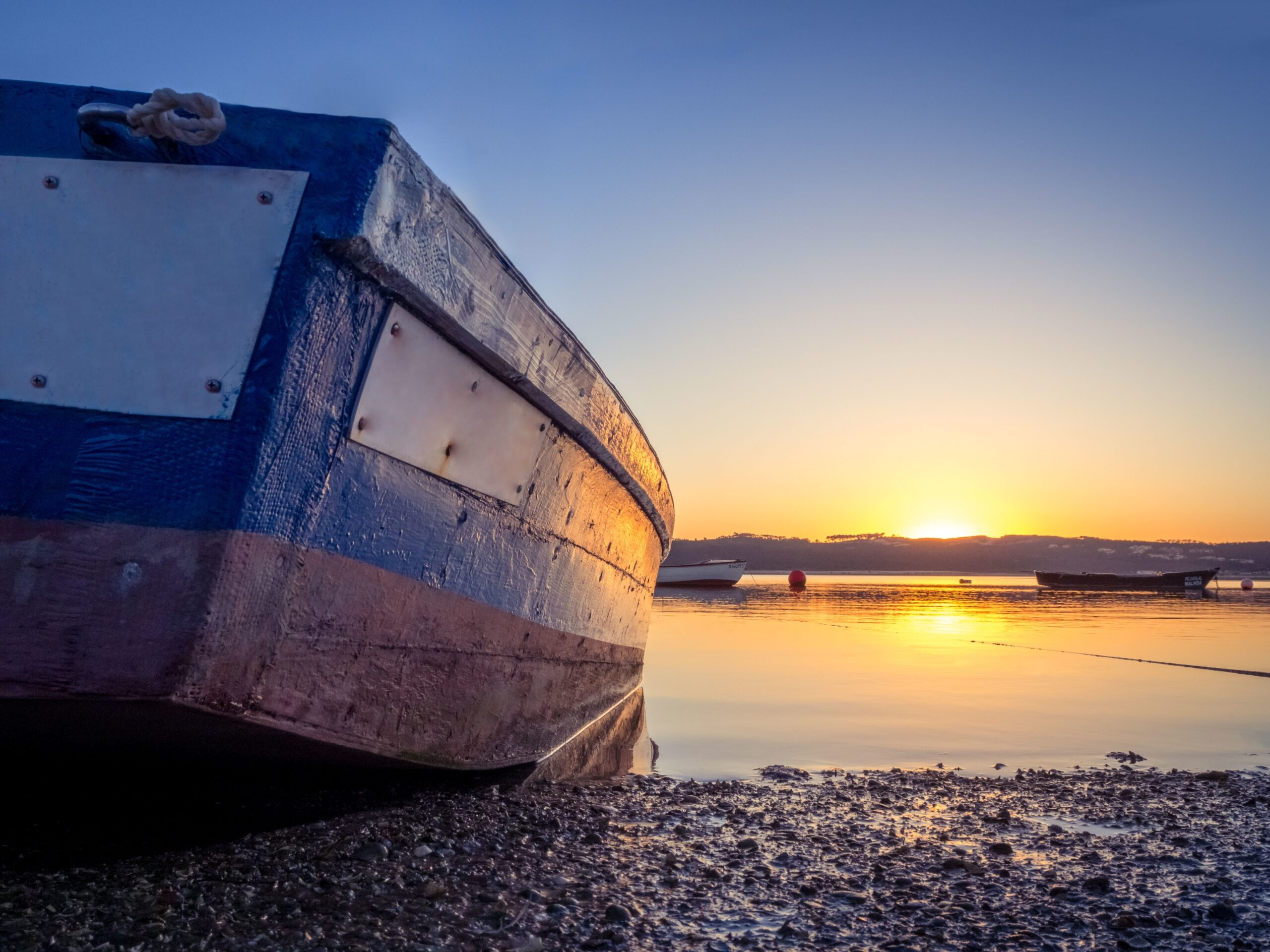 Fishing boat at the river with the beautiful sunset in the background